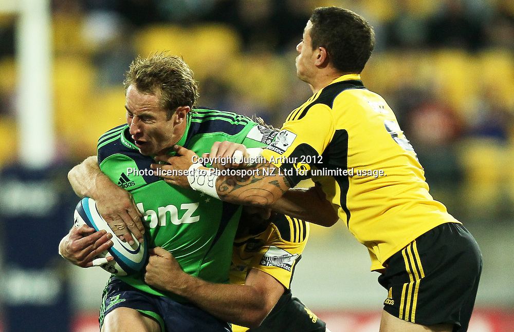 Highlanders' Jimmy Cowan gets wrapped up by the Hurricanes defense during the 2012 Super Rugby season, Hurricanes v Highlanders at Westpac Stadium, Wellington, New Zealand on Saturday 17 March 2012. Photo: Justin Arthur / Photosport.co.nz