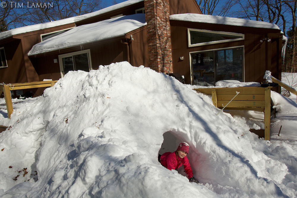 snow cave in a giant mound of snow behind the house made by shoveling off the deck.