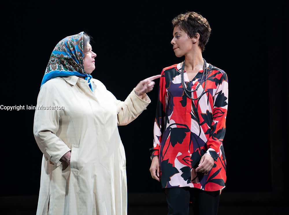 Edinburgh, Scotland, UK. 14 August 2019. Preview performance of the play Red Dust Road by the National Theatre of Scotland at the Lyceum Theatre during the Edinburgh International Festival 2019. <br /> Chronicling Jackie Kay's 20-year search for her biological mother and father and her quest for them to recognise her own existence. <br /> <br /> Red Dust Road is adapted from the memoir by Jackie Kay, poet, playwright, novelist and Scottish Makar. It's a journey full of heart, humour and profound emotion, exploring race, identity and family secrets, with a deeply human curiosity and compassion.<br /> Red Dust Road is adapted for the stage by Tanika Gupta, winner of last year's James Tait Black Prize for her drama Lions and Tigers. Pictured  Elaine C Smith ( Helen), Sasha Frost ( Jackie). Iain Masterton/Alamy Live News ++ Editorial Use Only ++