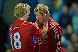 PORTSMOUTH, ENGLAND - Saturday, February 7, 2009: Liverpool's Fernando Torres celebrates scoring the winning third goal against Portsmouth with fellow match-winner Dirk Kuyt during the Premiership match at Fratton Park. (Mandatory credit: David Rawcliffe/Propaganda)