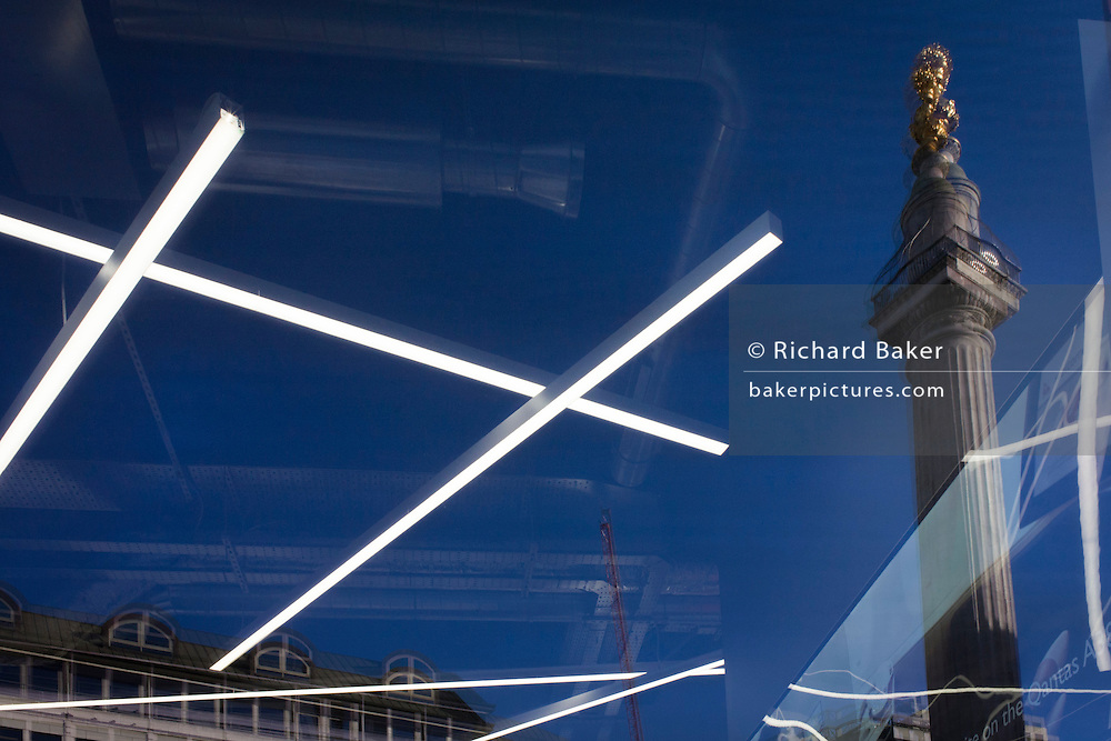 Travel agency strip lighting with London Monument landmark background.
