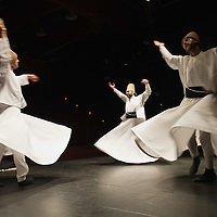 VENICE, ITALY - JUNE 21: Whirling Dervishes of the Galata Mevlevi Ensemble perfom at Auditorium Candiani on June 21, 2011 in Venice, Italy. The whirling dance associated with Dervishes, is the practice of the Mevlevi Order in Turkey, and is part of a formal ceremony known as the Sema which is only one of the many Sufi ceremonies performed to try to reach religious ecstasy