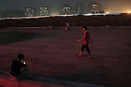 For a story by Dan Levin<br /> FOXCONN<br /> Zhengzhou, June 22nd 2013<br /> On a street still under construction.<br /> Gilles Sabrie for The New York Times