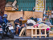 26 FEBRUARY 2016 - BANGKOK, THAILAND: A man with things he salvaged from abandoned shophouses in the Verng Nakorn Kasem neighborhood. Verng Nakorn Kasem, also known as the Thieves' Market, was one of Bangkok's most famous shopping districts. It is located on the north edge of Bangkok's Chinatown district, it grew into Bangkok's district for buying and selling musical instruments. The family that owned the land recently sold it and the new owners want to redevelop the famous area and turn it into a shopping mall. The new owners have started evicting existing lease holders and many of the shops have closed. The remaining shops expect to be evicted by the end of 2016.      PHOTO BY JACK KURTZ