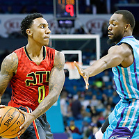 01 November 2015: Atlanta Hawks guard Jeff Teague (0) looks to pass the ball over Charlotte Hornets guard Kemba Walker (15) during the Atlanta Hawks 94-92 victory over the Charlotte Hornets, at the Time Warner Cable Arena, in Charlotte, North Carolina, USA.