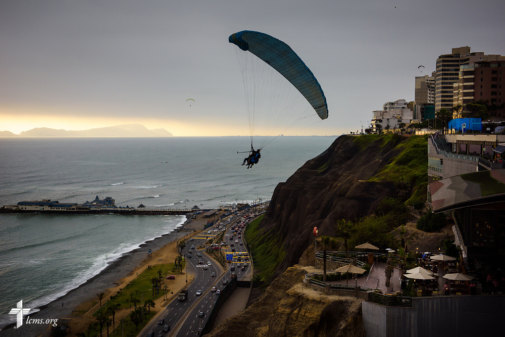 A recreational paraglider soars over Miraflores, an affluent and touristy part of Lima, Peru, on Monday, Nov. 6, 2017. LCMS Communications/Erik M. Lunsford