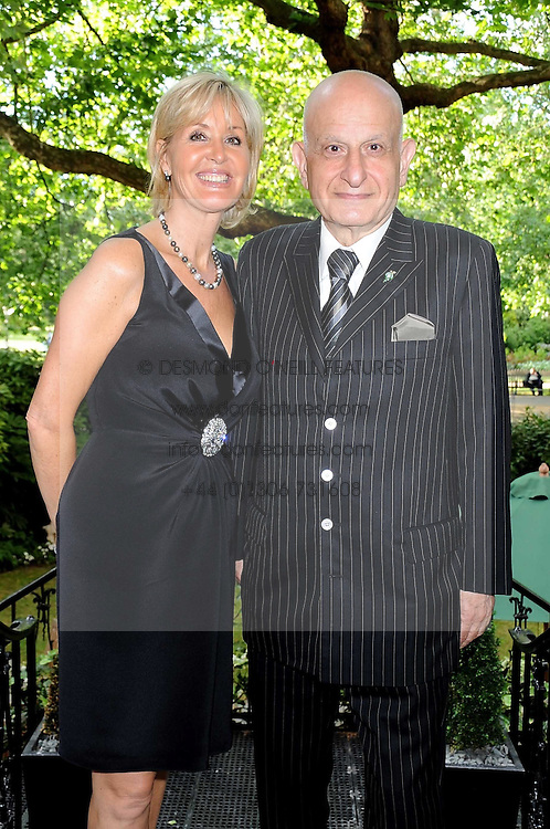 SUZY PARSONS and NAIM ATTALLAH at a party to celebrate the publication on 'Unsuitable' by Suzy Parsons held at St.Stephen's Club, 34 Queen Anne's Gate, London SW1 on 19th June 2008<br />