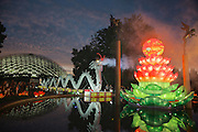 NIght photo by Leandra Lewis of Missouri Botanical Gardens Chinese Lantern Festival dueling porcelain dragons constructed  of plates, cups and saucers.