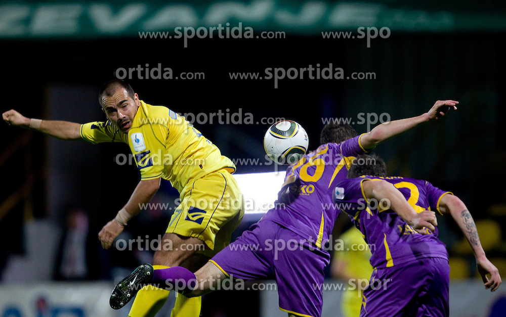 Sead Zilic of Domzale vs Aleksander Rajcevic of Maribor  during football match between NK Domzale and NK Maribor in 27th Round of Slovenian 1st League PrvaLiga, on April 9, 2011 in Sports park Domzale, Slovenia.  (Photo By Vid Ponikvar / Sportida.com)