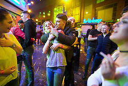 "© Licensed to London News Pictures . 23/12/2017. Manchester, UK. Revellers out on Withy Grove outside the Printworks in Manchester City Centre overnight during "" Mad Friday "" , named for being one of the busiest nights of the year for the emergency services in the UK . Photo credit: Joel Goodman/LNP"