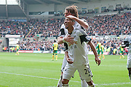 Swansea city's Jonathan De Guzman (20) celebrates with Michu after scoring his sides 1st goal .<br /> Barclays premier league match , Swansea city v Norwich city at the Liberty stadium in Swansea, South Wales on Saturday 29th March 2014.<br /> pic by Phil Rees, Andrew Orchard sports photography.