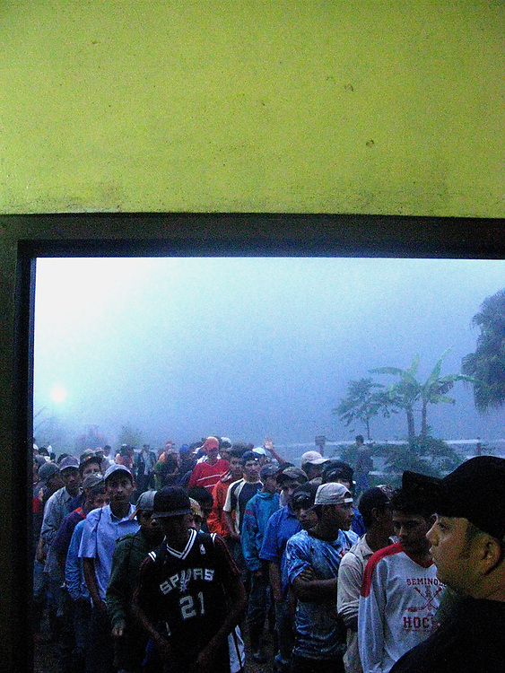 Coffee pickers lining up for assignment, coffee farm near Matagalpa, Nicaragua, 2010.