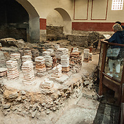 The caldarium of the Roman Baths of Bath in Somerset, United Kingdom. The tiled towers allowed steam to heat a lay of flooring that was placed on top of them.