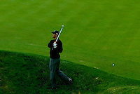 Tiger Woods, chips out of the rough from hole ten at day two of practices of the PGA championship at Whistling Straits Tuesday Aug. 10, 2004 Haven Wi.     Photo Darren Hauck...................................