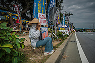 Protesters, mostly senior-citizens, are stationed in front of Camp Schwab in Henoko, where the Washington and Tokyo plan to relocate the Futenma US Marine Corps Air Base, and bury a pristine coral reef, habitat for the critically endangered dugong, similar to the manatee.  Science wrote in 2014, that there were only 10 dugong at best left in Okinawa Prefecture and that the base could seal their fate because it would threaten one of two remain beds of sea grass upon which it depends.  Henoko, Okinawa, Japan.  <br /> <br /> Since the protesters are, mostly senior citizens, it begs the question, why are young protesters not engaged in this issue?