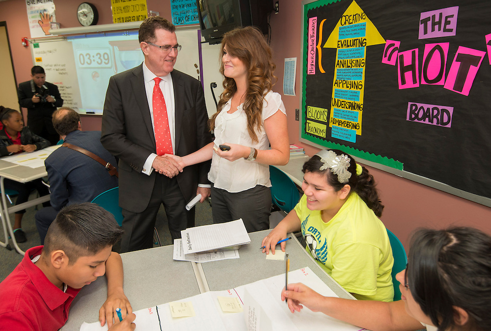 Houston ISD superintendent Dr. Terry Grier, left, talks with students and their teacher during a Broad Foundation research team tour Ortiz Middle School, May 29, 2013.