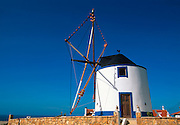 PORTUGAL, CENTRAL AREA traditional windmill, complete with sails, weights and jars