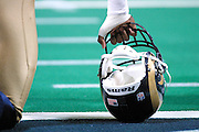 St. Louis Rams player rest on his helmet on the sideline of a 15 to 14 win over the New York Giants on 10/14/2001..©Wesley Hitt/NFL Photos