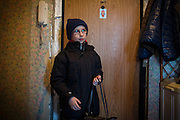 Yaroslav, 10, ready to go out and use his UNICEF video camera, is standing by the door of the provisional home where he resides with his mother Olga, 36, as internally displaced persons. (IDPs) Yeroslav is taking part to the UNICEF-sponsored One Minute Junior project for internally displaced persons (IDPs), carried out by the local NGO 'Ukrainian Frontiers' in the city of Kharkiv, the country's second-largest, in the east. The conflict between Ukrainian army and Russia-backed separatists nearby, in the Donbass region, have left more than 10000 dead since April 2014, including over 1000 since the shaky Minsk II ceasefire came into effect in February 2015. The approximate number of people displaced by the conflict is 1.4 million as of August 2015. Yeroslav's mother, Olga, is also a participant to a different project of 'Ukrainian Frontiers', called 'Self-Employment', first as a beneficiary, and now as a paid hotline coordinator for people seeking jobs and formation courses.