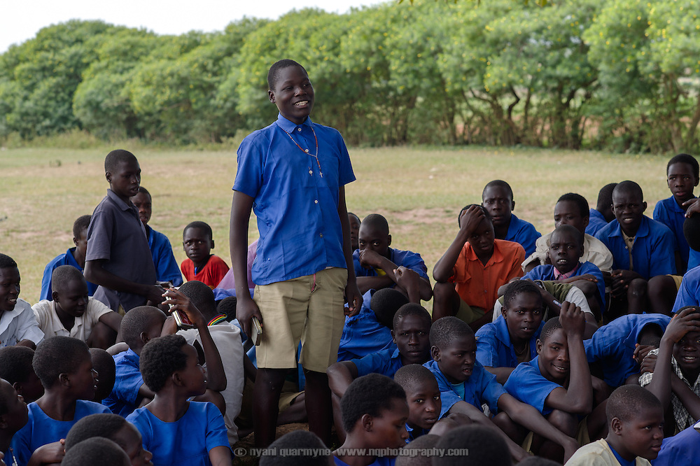 A student stands to answer a question during a presentation on Menstrual Hygiene Management at Aputiri Primary School in Eastern Uganda on 31 July 2014.