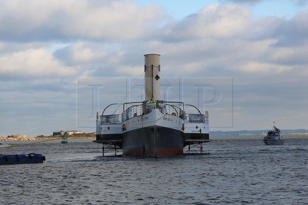 © Licensed to London News Pictures. 19/11/2013. Historic paddle steamer Medway Queen has made an emotional return to the River Medway. Her hull has been rebuilt at Bristol and now work will continue on her restoration at Medway. She was one of the Little Ships of Dunkirk, making seven trips and rescuing 7,000 men during the evacuation. Credit : Rob Powell/LNP