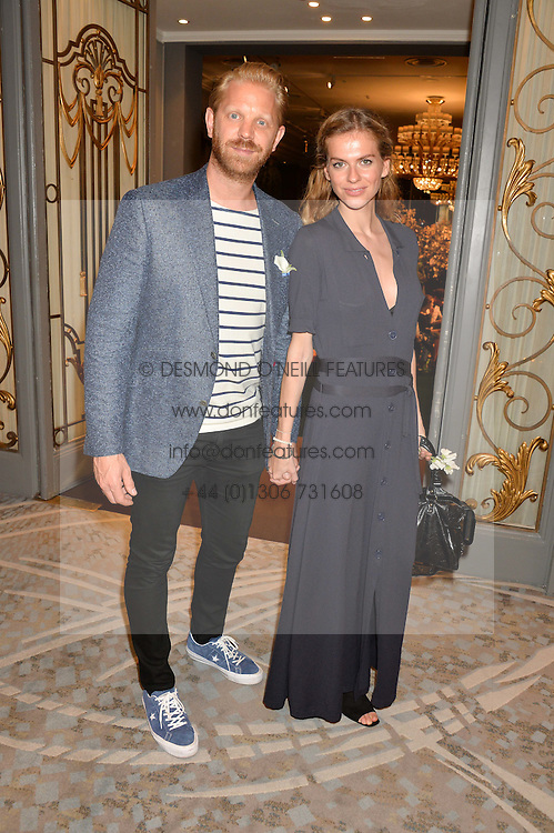 ALISTAIR GUY and BARBORA BEDIOVA at an English Garden party to celebrate the re-launch of the Grosvenor House Hotel, Park Lane, London on 21st June 2016.