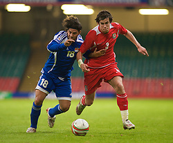 CARDIFF, WALES - Saturday, October 11, 2008: Wales' Gareth Bale and Liechtenstein's Michele Polverino during the 2010 FIFA World Cup South Africa Qualifying Group 4 match at the Millennium Stadium. (Photo by Gareth Davies/Propaganda)