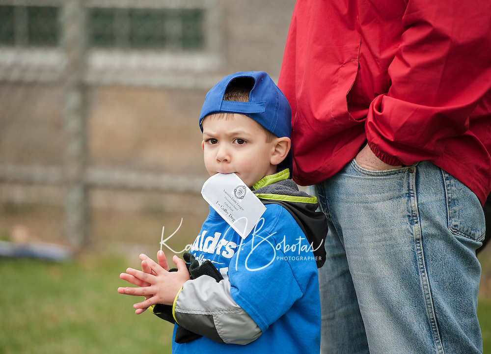 """Cameron McClary of the Boulders Motel T Ball team is """"chomping at the bit"""" for his first Colby Dog of the season during opening day festivities for Laconia Little League at Colby Field on Saturday morning.  (Karen Bobotas/for the Laconia Daily Sun)"""