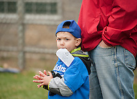 "Cameron McClary of the Boulders Motel T Ball team is ""chomping at the bit"" for his first Colby Dog of the season during opening day festivities for Laconia Little League at Colby Field on Saturday morning.  (Karen Bobotas/for the Laconia Daily Sun)"