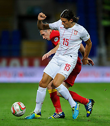 Ljubomir Fejsa of Serbia (Benfica) and Andrew Crofts of Wales (Brighton) compete for the ball during the second half of the match - Photo mandatory by-line: Rogan Thomson/JMP - Tel: Mobile: 07966 386802 10/09/2013 - SPORT - FOOTBALL - Cardiff City Stadium - Cardiff -  Wales V Serbia- World Cup Qualifier.