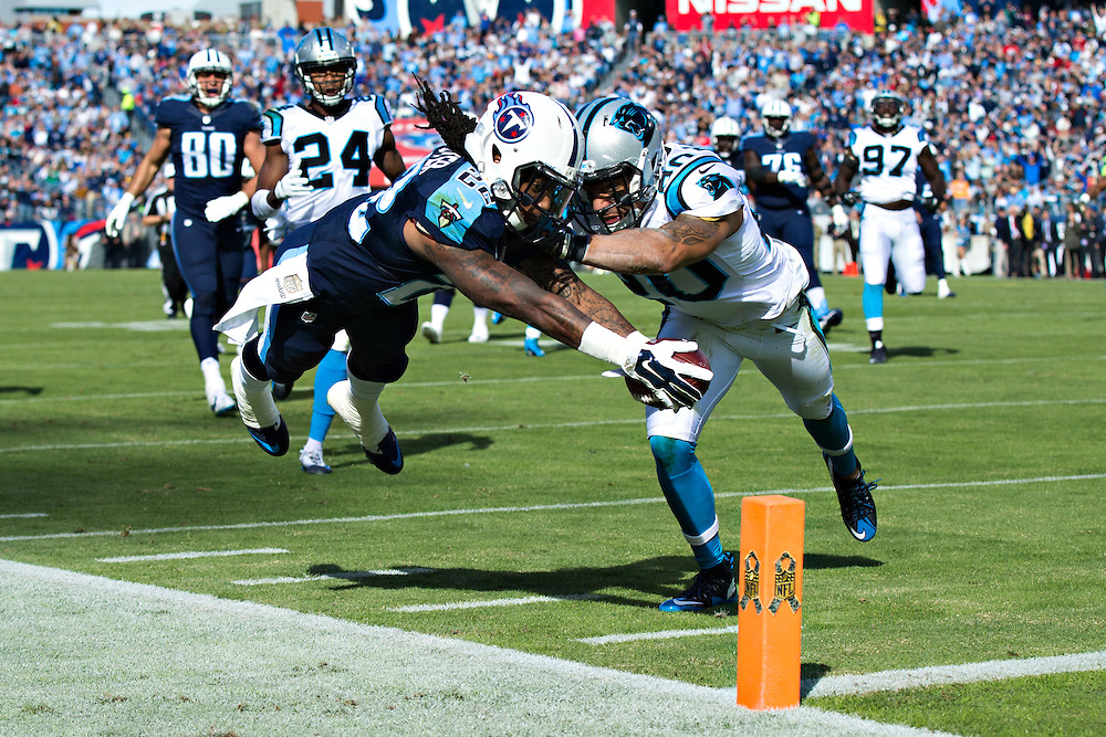 NASHVILLE, TN - NOVEMBER 15:  Dexter McCluster #22 of the Tennessee Titans dives for the end zone corner marker while being hit by Kurt Coleman #20 of the Carolina Panthers at Nissan Stadium on November 15, 2015 in Nashville, Tennessee.  (Photo by Wesley Hitt/Getty Images) *** Local Caption *** Dexter McCluster; Kurt Coleman