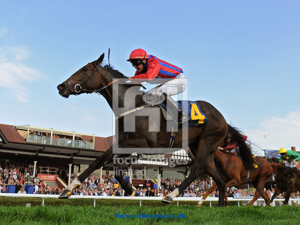 Picture by Alan Wright/Focus Images Ltd 07733 196489<br /> 28/09/2013<br /> Blithe Spirit and jockey Neil Farley win The Advanced Insulation Nursery Handicap Stakes at Chester Racecourse , Chester.