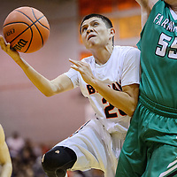 Gallup Bengal Ronald Lee (20) collides with Farmington Scorpion David Riley (55) as he tries for a layup Friday at Gallup High School.