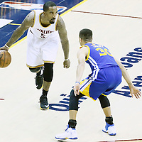 08 June 2016: Golden State Warriors guard Stephen Curry (30) defends on Cleveland Cavaliers guard J.R. Smith (5) during the Cleveland Cavaliers 120-90 victory over the Golden State Warriors, during Game Three of the 2016 NBA Finals at the Quicken Loans Arena, Cleveland, Ohio, USA.