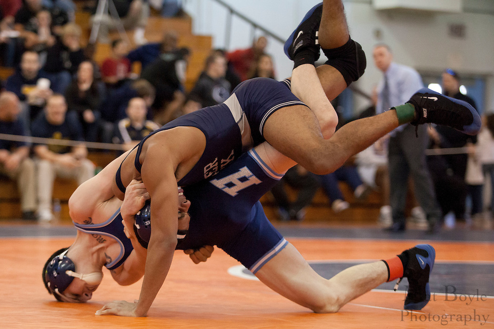 Isiah DeGuzman of Timber Creek High School vs. Mike Graham of Williamstown High School during the District 30 Wrestling 138 lbs weight class Semi-final at Overbrook High School on February 18, 2012. (photo / Mat Boyle)