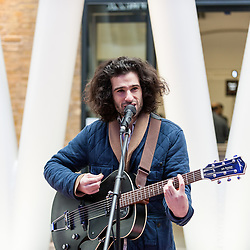 © Licensed to London News Pictures. 16/03/2016. London, UK. King Charles performs.  Buskers and street performers entertain morning commuters in King's Cross station, as this year's Busk in London programme is launched.  Supported by the Mayor of London, the festival joins the International Busking Day and National Busking Day initiatives to celebrate street performances. Photo credit : Stephen Chung/LNP