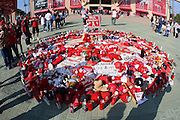 ANAHEIM, CA - APRIL 22:  Memorabilia is piled up in a fan area dedicated to deceased pitcher Nick Adenhart #34 of the Los Angeles Angels of Anaheim prior to the game against the Detroit Tigers at Angel Stadium on Wednesday, April 22, 2009 in Anaheim, California.  The Tigers defeated the Angels 12-10.  (Photo by Paul Spinelli/MLB Photos via Getty Images) *** Local Caption *** Nick Adenhart