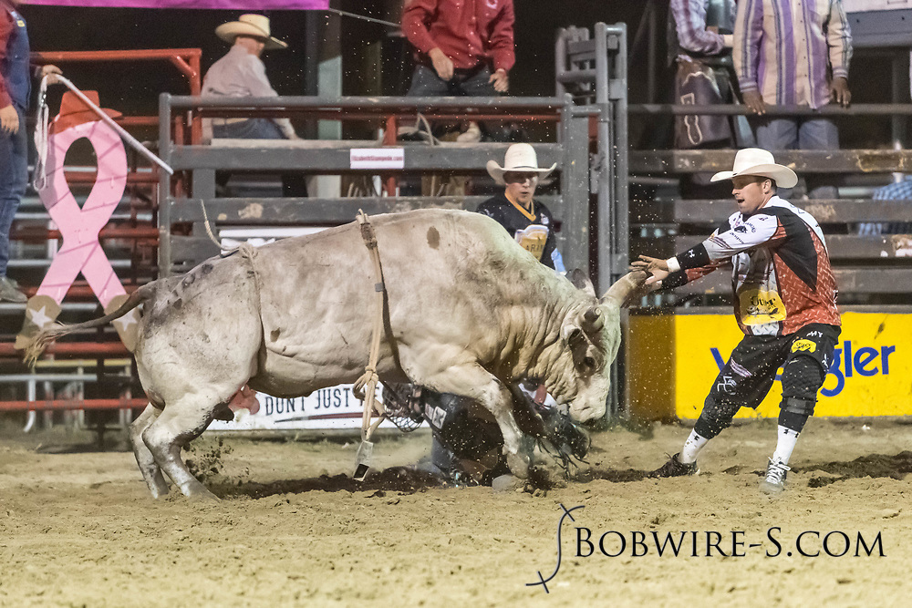 Bullfighters Nate Jestes (right) and Cade Burns rescue bull rider Brandon Olson from Summit Pro Rodeo's Ice Baby in the second performance of the Elizabeth Stampede on Saturday, June 2, 2018.