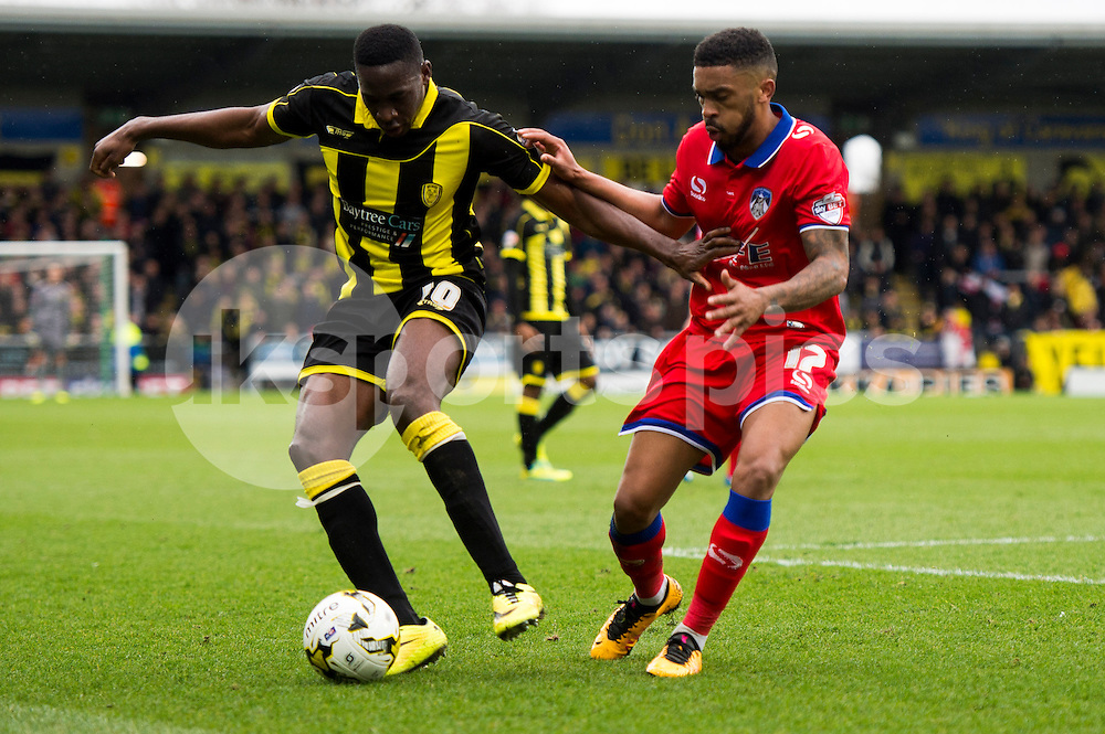 Lucas Akins of Burton Albion and David Dunn of Oldham Athletic AFC compete for the ball during the Sky Bet League 1 match between Burton Albion and Oldham Athletic at the Pirelli Stadium, Burton upon Trent, England on 26 March 2016. Photo by Brandon Griffiths.