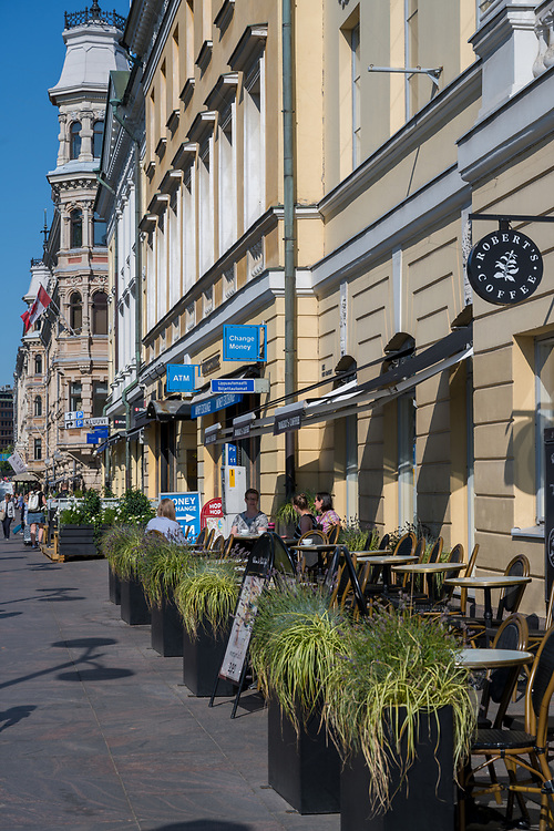Helsinki, Finland -- July 19, 2019. Photo of an outdoor cafe and coffee shop on a busy street in Helsinki, Finland.