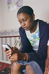 Teenage girl using mobile phone,