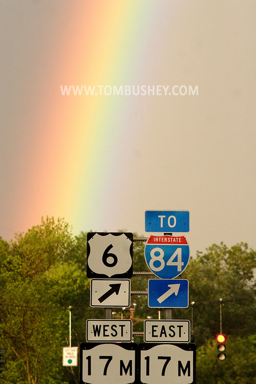 Wawayanda, New York - A rainbow in the sky over highway signs in Orange County on May 8, 2010.