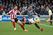 Coventry City Midfielder Jodi Jones in action Lincoln City Defender Neal Eardley gives chase during the EFL Sky Bet League 2 match between Lincoln City and Coventry City at Sincil Bank, Lincoln, United Kingdom on 18 November 2017. Photo by Craig Zadoroznyj.