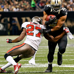 Dec 29, 2013; New Orleans, LA, USA; New Orleans Saints running back Mark Ingram (22) breaks away from Tampa Bay Buccaneers cornerback Johnthan Banks (27) during the second half of a game at the Mercedes-Benz Superdome.The Saints defeated the Buccaneers 42-17. Mandatory Credit: Derick E. Hingle-USA TODAY Sports