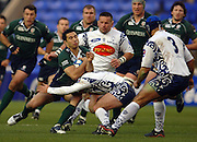 2005/06, European Challenge Cup, Exile Riki Flutey's run is stopped by  a low tackle from the Agen defence as London Irish vs Agen,  at the Madejski Stadium, Reading, ENGLAND   © Peter Spurrier/Intersport Images - email images@intersport-images..   [Mandatory Credit, Peter Spurier/ Intersport Images].