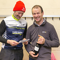 Brian Nevin presenting Anthony O'Halloran from Ruan winner of B Race with a bottle of wine