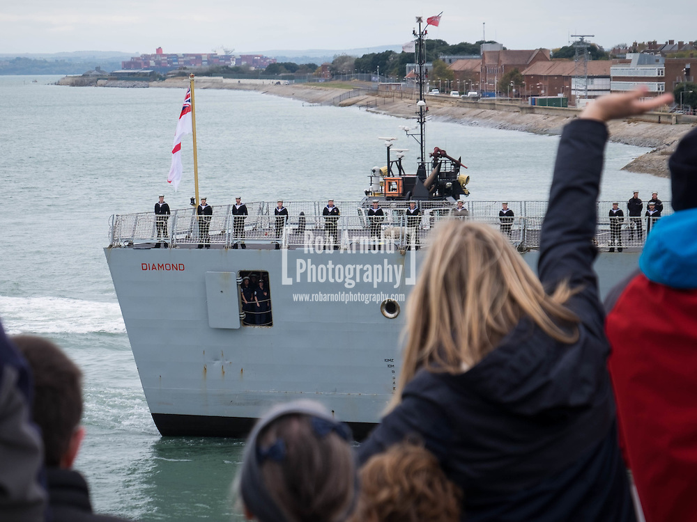 Relatives welcoming the Royal Navy Type 45 Destroyer HMS Diamond back to Portsmouth after completing her two month operation countering the illegal arms trade into Libya. The Portsmouth-based Destroyer has now handed over duties in the Central Mediterranean Sea to another Royal Navy ship, RFA Mounts Bay.