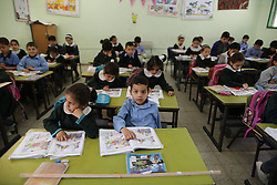 Palestinian students take part in a class at an al-Qahera elementary mixed school in Gaza City, on April 2, 2013. New rules from the Education Ministry of the Islamist Hamas movement would bar men from teaching at girls schools and mandate separate classes for boys and girls from the age of nine, on April 2, 2013. Photo by Imago / i-Images...UK ONLY..
