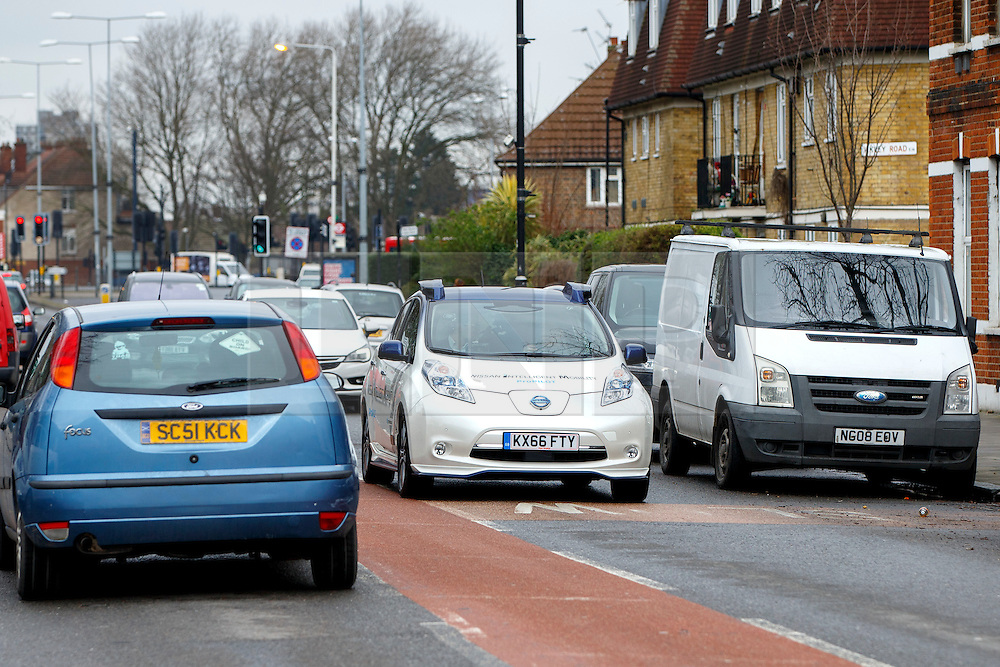 © Licensed to London News Pictures. 03/03/2017. London, UK. A driverless Nissan Leaf car is being tested on a public high street in east London on Friday, 3 March 2017 on its week-long trial for the first time anywhere in Europe. Since Monday, the firm reported the cars travelled hundreds of miles with no collisions and only a handful of incidents in which engineers had to intervene to prevent a crash. Photo credit: Tolga Akmen/LNP