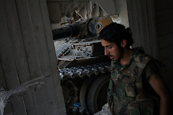 Syria<br /> A member of the free Syrian army walks in a secret garage besides a T-72 tank belonging to the FSA close to al-rami village.<br /> Rebels and activists have been reporting heavy clashes between rebels and government forces in Idlib province as government troops are trying to take control of the highway that leads to the neighbouring Latakia province, Idlib<br /> Syria<br /> Saturday, 22nd June 2013<br /> Picture by Daniel Leal-Olivas / i-Images